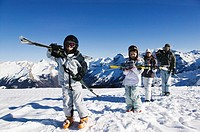 Family with two children 6-8 on ski slope