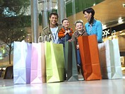 Parents with children 4-7 in mall, focus on background