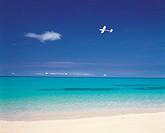 A Plane Flying Near The Coastline