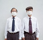 Two businessmen wearing pollution masks