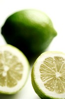 Close-up of two limes cut in half