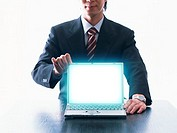 Image of businessman with laptop