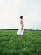 Young woman standing on field