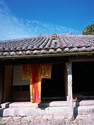 Traditional Okinawa house and clothes
