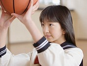 Schoolgirl playing basketball