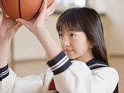 Schoolgirl playing basketball