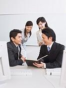 Smiling businessmen having a conversatrion
