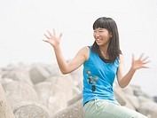 Girl opening her arms with a big smile