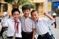 Portrait of three boys showing peace sign. The Old Quarter, Hanoi, Vietnam, Indochina, Southeast Asia, Asia 2006