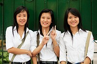 Portrait of teen smiling girls on showing peace sign. The Old Quarter, Hanoi, Vietnam, Indochina, Southeast Asia, Asia 2006