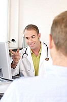 Male doctor talking to patient and smiling