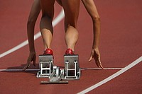 Female athlete on starting blocks