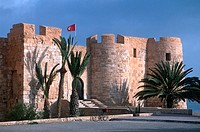 Castle on roadside under clear blue sky, Bordj El Kebir, Djerba, Tunisia