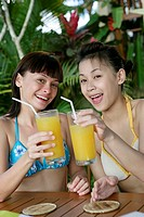 Portrait of teenage girls having juice