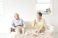 Senior Adult Couple Having a Break, Drinking Coffee, Front View