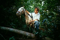 Man with horse in forest