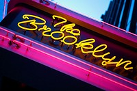 Low angle view of a neon sign, New York City, New York State, USA