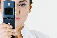 Close-up of a young woman holding a mobile phone (thumbnail)