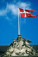 Danish flag fluttering on a sculpture, Amalienborg Palace, Copenhagen, Denmark