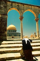 Rear view of a man walking up steps of a shrine, Dome Of The Rock, Jerusalem, Israel