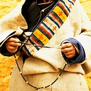 Mid section view of a person holding prayer beads, Lhasa, Tibet, China