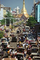High angle view of traffic on the road with a pagoda in the background, Sule Pagoda, Yangon, Myanmar