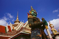 Low angle view of statues in front of a temple, Wat Arun, Bangkok, Thailand