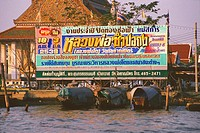 Billboard at a riverbank, Bangkok, Thailand