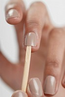 Close-up of a woman´s hand giving herself a manicure