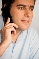 Close-up of a young man using a mobile phone