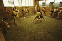 Sumo wrestlers practicing in a ring, Tokyo Prefecture, Japan