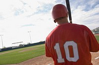 Baseball player looking into the feild