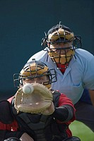 Catcher receiving a pitch