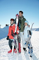 Father with His Two Children Standing on a Ski Slope