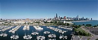 ´This is an aerial view of the Shedd Aquarium, Chicago Harbor and the skyline on Lake Michigan during summer  Boats are moored in the harbor in the fo...