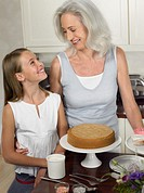 Grandmother and Granddaughter Looking Face to Face in a Kitchen