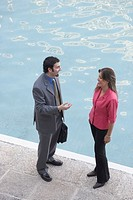 High angle view of a businessman talking to a businesswoman
