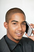 Young man holding mobile phone to ear, portrait
