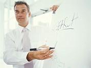 Businessman writing on flipchart, close up
