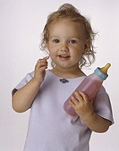 Girl 2-3 holding bottle, smiling, posing in studio, Portrait