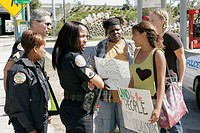 Florida, Miami, Pinnacle Park, affordable housing. Groundbreaking ceremony. Black female police officer, protesters