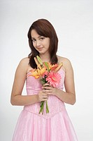 Portrait of a teenage girl holding a bouquet of flowers