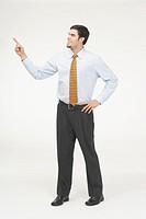 Side profile of a businessman pointing forward