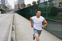 USA, California, San Diego, man jogging along overpass