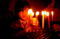 Boy Holding Hanukkah Candles