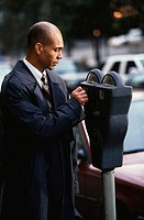 Businessman Feeding Parking Meter