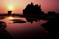 Indonesia, Bali, Tanah Lot Temple at sunset, Reflections in water
