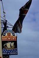 Channel Islands, Guernsey, pub's sign and British flag