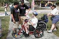Family Festival of the Arts, disabled children activities, arm powered tricycle, wheelchair. Kendall. Miami. Florida. USA.