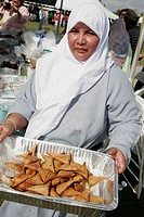 Asian Culture Festival, Bangladesh Muslim woman, food, hijab head scarf. Fruit and Spice Park. Homestead. Florida. USA